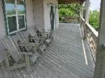 Mid-level deck.  Plenty of shade and furniture.  Don't miss our swing!