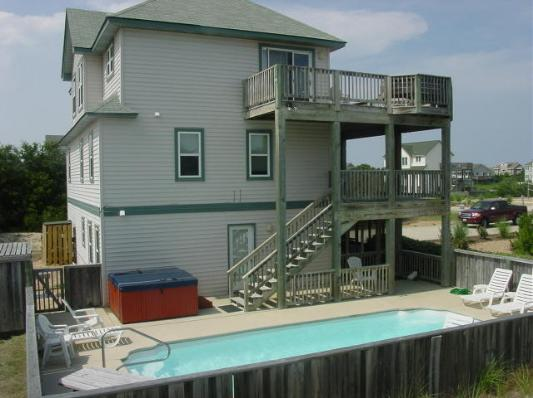 Here is a side view of Smileaway....large decking, pool and spa
